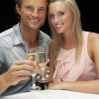 Young couple in restaurant — Foto de Stock