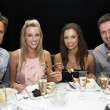 Two young couples in restaurant — Stock Photo #11886228