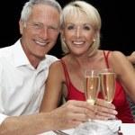 Senior couple in restaurant — Stock Photo #11886232