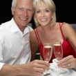 Senior couple in restaurant — Stock Photo #11886234