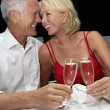 Senior couple in restaurant — Stock Photo
