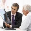 Stock Photo: Doctor with senior patient
