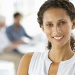 Young businesswoman in office — Stock Photo