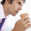 Businessman drinking coffee — Stock Photo