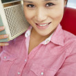 Stock Photo: Young womlistening to radio