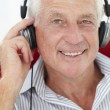 Senior man with headphones - Stock Photo