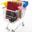 Trolley full of items for holiday - Stock Photo
