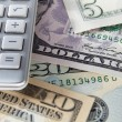 Detail dollar bills and calculator — Stock Photo