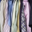 Stock Photo: Rail of men's shirts