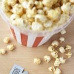 Popcorn and cinema tickets — Stock Photo