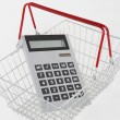 Supermarket basket and calculator — Stock Photo #11886958