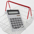 Supermarket basket and calculator — Stock Photo