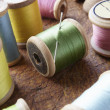 Stock Photo: Cotton reels on table top