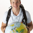 Young traveller with globe - Stockfoto