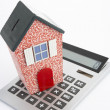 Model house and calculator - Stock Photo