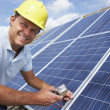 Royalty-Free Stock Photo: Man installing solar panels