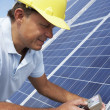Stock Photo: Man installing solar panels