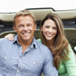 Foto Stock: Couple outdoors with car
