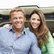Couple outdoors with car - Foto de Stock