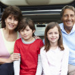 Hispanic grandparents and grandchildren outdoors - 