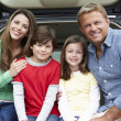 Family outdoors with car - Stockfoto