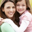 Stock Photo: Portrait Hispanic mother and daughter