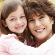 Hispanic grandmother and granddaughter — Stock Photo