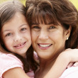 Stock Photo: Hispanic grandmother and granddaughter
