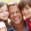 Stock Photo: Portrait father and children outdoors