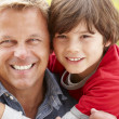 Portrait father and son outdoors — Stock Photo