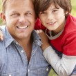 Photo: Portrait father and son outdoors