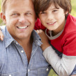 Stockfoto: Portrait father and son outdoors