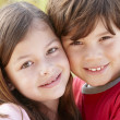 Portrait hispanic brother and sister outdoors - Foto Stock