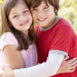 Portrait hispanic brother and sister outdoors — Stock Photo
