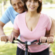 Senior Hispanic couple with bike — Stock Photo #11887518