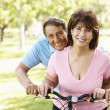 Senior Hispanic couple with bike — Stock Photo #11887520