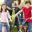 Stock Photo: Family riding bikes in park