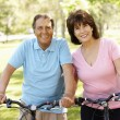 Senior Hispanic couple on bikes — Foto de Stock