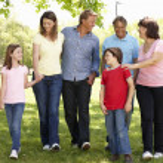 Multi generation Hispanic family in park — Stock Photo #11887608