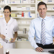 UK nurse and pharmacist working in pharmacy — Stock Photo