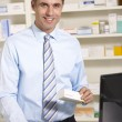 Foto de Stock  : UK pharmacist at work