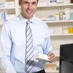 UK pharmacist at work — Stock Photo