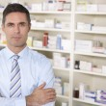 Portrait UK pharmacist at work — Stock Photo