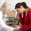 American doctor with depressed woman patient - Stockfoto