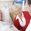 Royalty-Free Stock Photo: Doctor talking to senior couple on USA Hospital ward