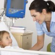 Nurse with child patient in UK Accident and Emergency — Stock Photo #11888141