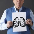 Senior man holding ink drawing of lungs — Stockfoto