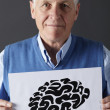 Stock Photo: Senior mholding ink drawing of brain