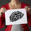 Senior woman holding ink drawing of brain — Stok fotoğraf