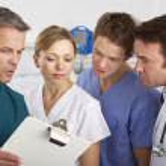 American medical team working on hospital ward — Stock Photo